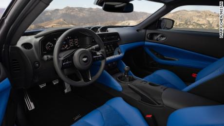 The interior of the new Nissan Z has three analog gauges that, designer Alfonso Albaisa said, are a nod to the car's early roots. The center console has a digital touchscreen, though.