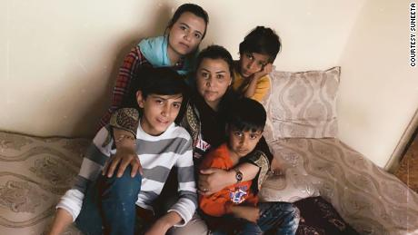 She's constantly calling her four young children who are hiding in a Kabul apartment