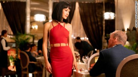 Maggie Q and Michael Keaton in 'The Protégé' (Jichici Raul).