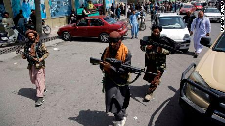 Taliban fighters patrol  Kabul on Thursday, Afghanistan's Independence Day.
