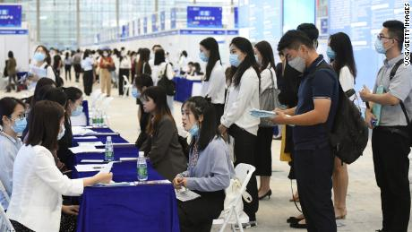 University graduates crowd at a job fair at Shenzhen Convention and Exhibition Center on October 10, 2020, in Shenzhen, Guangdong province of China.