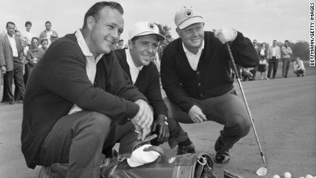 Palmer, Player and Nicklaus pose with their golf clubs before a practice round at the Firestone Country Club in Akron, Ohio.