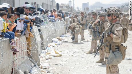 US Marines provide assistance during an evacuation at Hamid Karzai International Airport, Kabul, Afghanistan, on August 20.