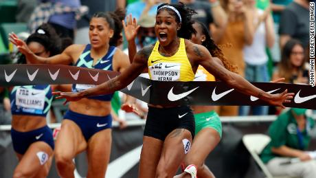 Elaine Thompson-Herah of celebrates winning the women's 100m on Saturday.