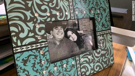 A framed photo of Carla and Sammy Balderas sits on Carla's desk at the city building. Carla has been in quarantine with her young son, while her husband was hospitalized with Covid-19. Sammy Balderas passed away on August 19.
