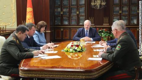 Belarusian President Alexander Lukashenko, center, attends an urgent security meeting after the arrest of the mercenaries.