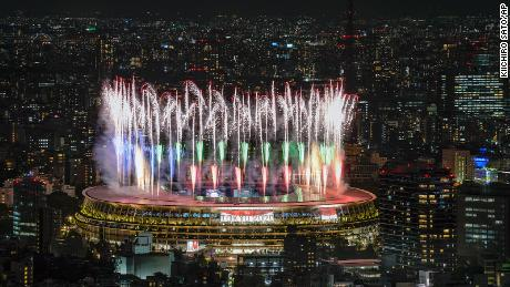 Fireworks illuminate the skies of Tokyo over the National Stadium during the Opening Ceremony.