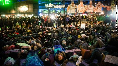 Demonstrators stage a die-in to protest a grand jury's decision not to indict a police officer involved in the death of Eric Garner in 2014.