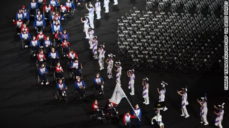 RPC team members parad during the opening ceremony for the Tokyo 2020 Paralympic Games at the Olympic Stadium in Tokyo on August 24, 2021.