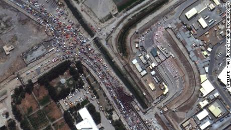 A satellite image shows crowds at a gate to Kabul's airport on August 23 in Afghanistan.