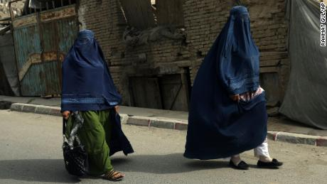 Taliban tell Afghan women to stay home from work because soldiers are 'not trained' to respect them