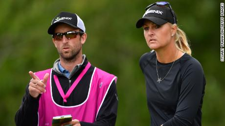 Nordqvist discusses a shot with her caddie during the final round of The Evian Championship in 2017.
