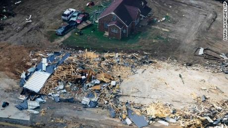Damaged homes and cars seen in Waverly, Tennessee.