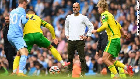 Guardiola looks on during the Premier League match between Manchester City and Norwich City.