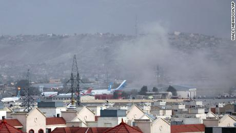 Smoke rises from an explosion outside the airport on August 26 in Kabul, Afghanistan.
