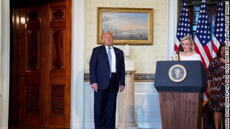 Cleta Mitchell speaks during an event marking the 100th Anniversary of the 19th Amendment ratification with President Donald Trump, left, in the Blue Room of the White House on August 18, 2020.