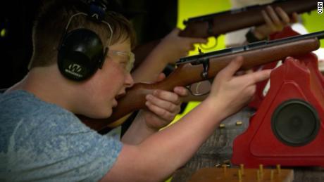 Ashton Morse, 11, fires a gun at a 4-H  Club training event in Sandgate, Vermont.