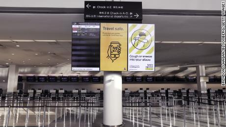 An information board in a deserted check-in hall at the Auckland Airport on July 7, 2020.