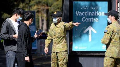 Australian Defense Force personnel assist the public at a Covid-19 vaccination clinic in Sydney on August 18, 2021.
