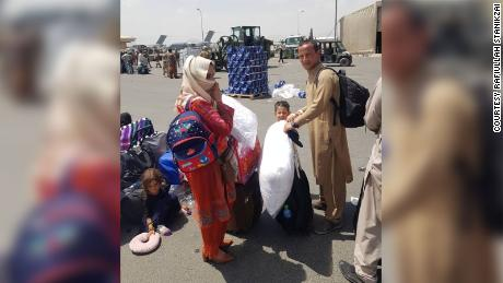 Rafiullah Stanikzai and his family are pictured being evacuated from Kabul on Thursday, August 19.