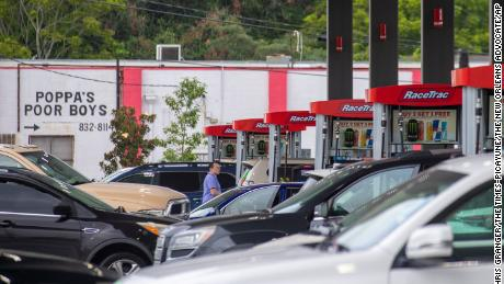 Long lines build at a gas station in Jefferson, Louisiana,  as people prepare for the arrival of Hurricane Ida on Friday, Aug.  27, 2021.