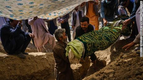 Relatives of a man who was killed in the Kabul airport bomb carry his body during his funeral on Martyrs Hill on the outskirts of the Afghan capital on Friday.