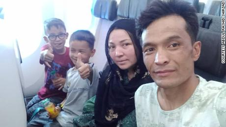 Shirzad and his family on the plane from Kabul to Bahrain on August 24.