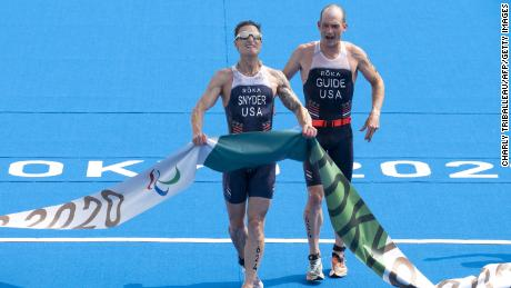 Snyder and his guide Greg Billington compete in the men's triathlon category PTVI during the Tokyo 2020 Paralympics at the Odaiba Marine Park.