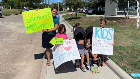 Stacie Smith and her children, Willow, Frances, Winnie, Lewis, and Patrick joined a demonstration to advocate for a mask mandate at Humble ISD Monday.