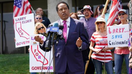 In this July 14, 2021, file photo, radio talk show host Larry Elder speaks to supporters during a campaign stop in Norwalk, California.