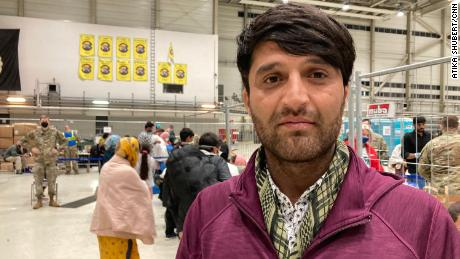 Asadullah Sadiqi, 25, waits to board a flight from Ramstein Air Base for Virginia to join his family.