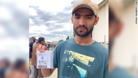 Mohammad Nirwaz Maiwand, 32, displays his US DEA ID, part of his documentation for a Special Immigrant Visa to the US.