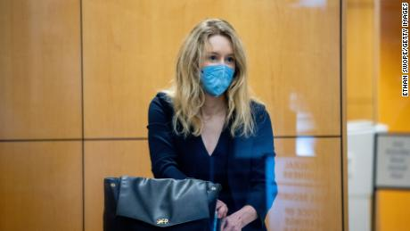 Holmes collects her belongings after going through security at the Robert F. Peckham Federal Building with her defense team on August 31, 2021 in San Jose, California.