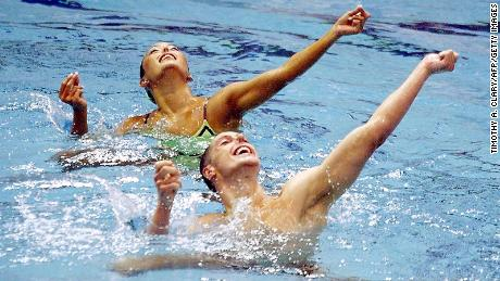 """Minisini says he fell in love with artistic swimming after seeing American Bill May (right) -- the """"god of synchronized swimming."""""""