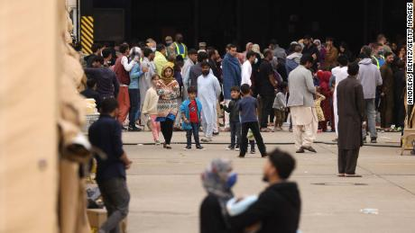 Evacuees from Afghanistan are seen at a temporary emergency shelter at the Ramstein Air Base on August 26.