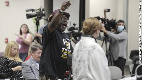 """Ben Frazier, the founder of the Northside Coalition of Jacksonville, chants """"Allow teachers to teach the truth"""" at the end of his public comments opposing Florida's plan to ban critical race theory in public schools, June 10, 2021."""