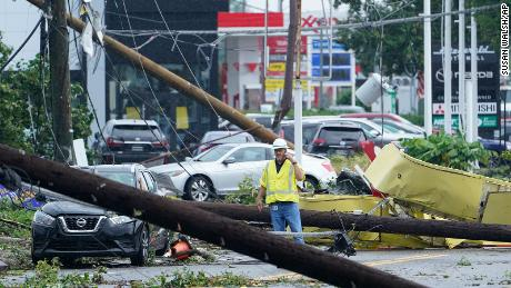 A man surveys the debris strewn along a street in Annapolis, Maryland.