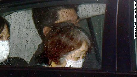 A police car carrying Chisako Kakehi leaves a detention facility in Osaka, Japan, on January 30, 2015.