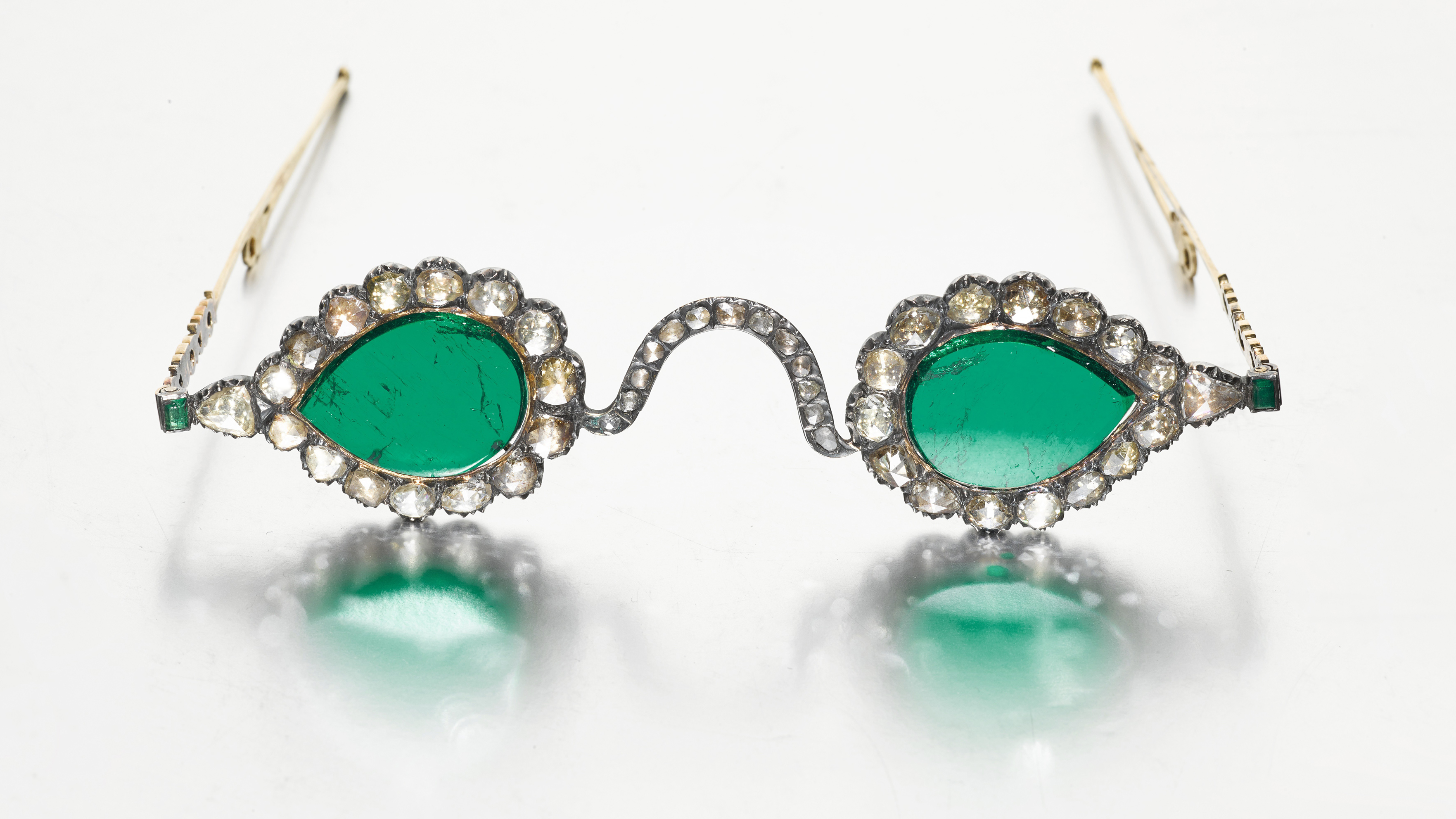 """The """"Gate of Paradise"""" glasses are thought to have been cut from a Colombian emerald."""