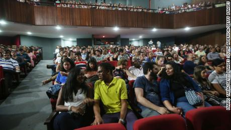 People attend a theatrical performance on April 18, 2015, in Salvador, Brazil.