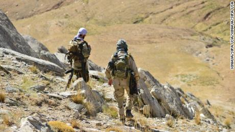 Anti-Taliban fighters patrol the Anaba District of Afghanistan's Panjshir province on September 1.