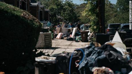 Residents sort through damaged and destroyed items in the Flushing neighborhood of the Queens borough of New York City.