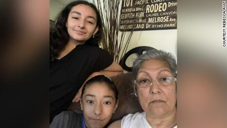After losing her husband to Covid-19, Rebecca Ruiz is home schooling her two granddaughters because she fears they could catch the coronavirus at school.