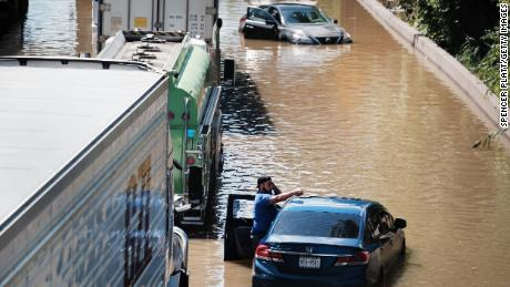 Cars sit abandoned on the flooded Major Deegan Expressway in the Bronx, New York, following a night of heavy wind and rain from the remnants of Hurricane Ida.
