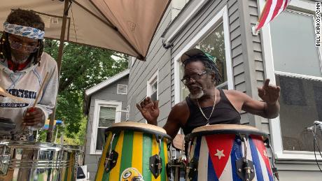 Norberto Gomez Mendez plays the drums that half show support for the Green Bay Packers and the other half for Cuba.