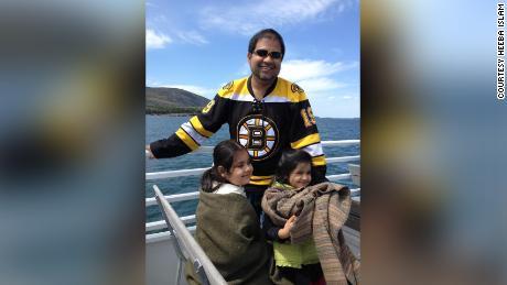 Nakibur Rahman and his two daughters.
