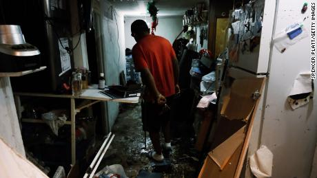 Eddie, an immigrant from Mexico, walks through his flooded basement level apartment in a Queens neighborhood that saw massive flooding and numerous deaths following a night of heavy wind and rain from the remnants of Hurricane Ida on September 3, 2021 in New York City.