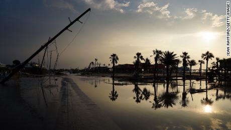 A road is partially covered in floodwater in the wake of Hurricane Ida on September 3, 2021 in Grand Isle, Louisiana.