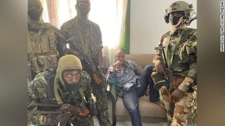 A social media image appears to show President Alpha Conde surrounded by soldiers.