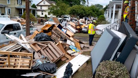 Utility workers work Sunday among debris from flood damage caused by the remnants of Hurricane Ida in Manville, New Jersey.